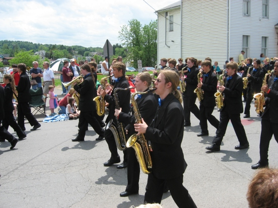 my son playing his tenor sax in the WV Strawberry Festival parade in 2009