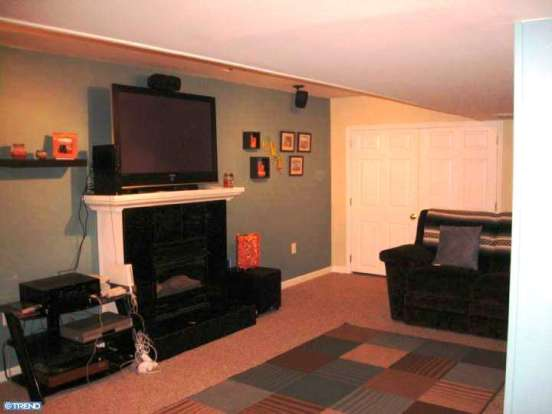 basement with gas fireplace