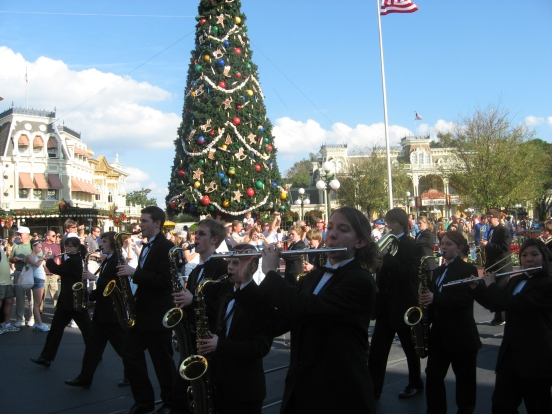 my son marching on Main Street USA, playing his tenor sax, 3rd over from the right, in 2007