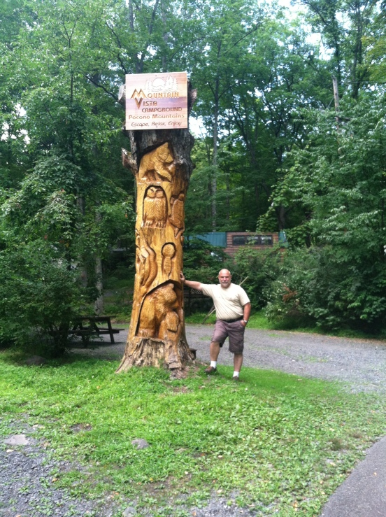 Bill next to the totem!