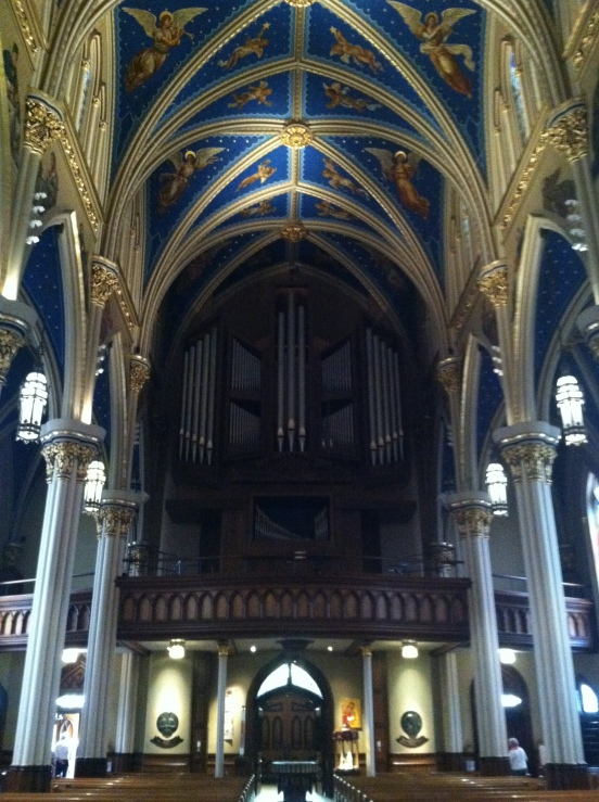 facing the back, the choir loft and organ pipes