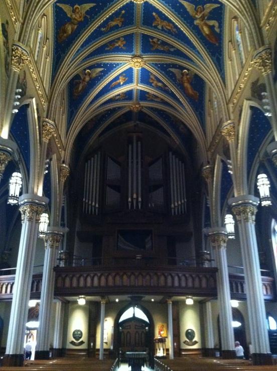facing the back, the choir loft and organ pipes