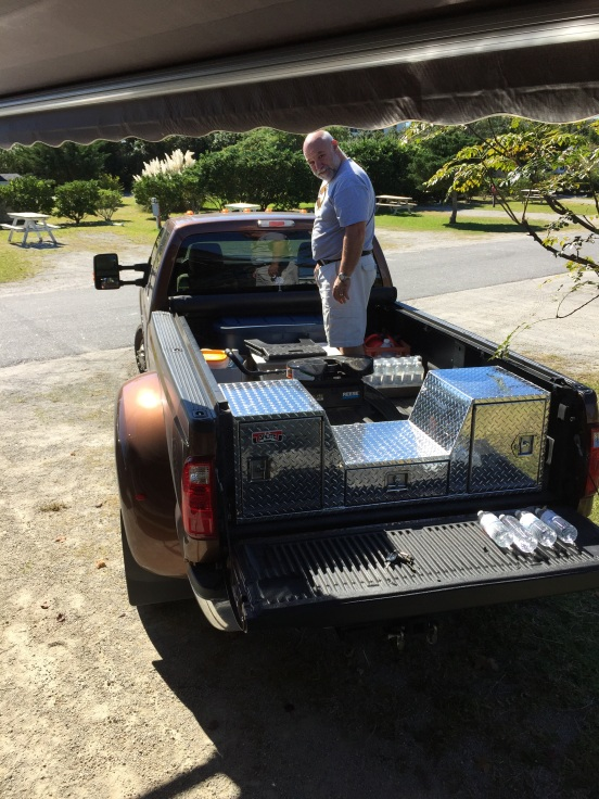 hubby getting stuff out of the back of the truck - notice his new toolbox?