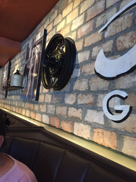 where else would you see hubcaps on the wall?