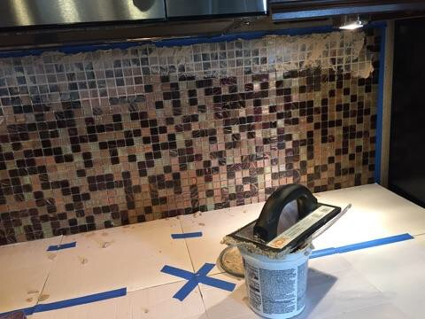 after he covered the countertop to protect it, he started the grout