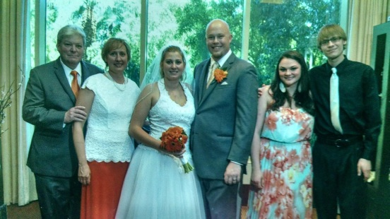 father of the bride, Jim, mother of the bride, Linda, bride, Jessilynn, groom, Mike, GF of the brother of the bride, Brittany and brother of the bride, Jimmy