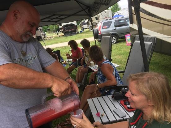 Bill, pouring Cori a strawberry daquiri