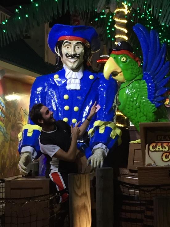 Alberto posing with the parrot - he even let the parrot borrow his TX baseball cap!
