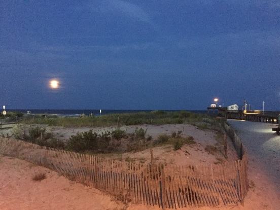 watching the super-moon rise over the ocean!