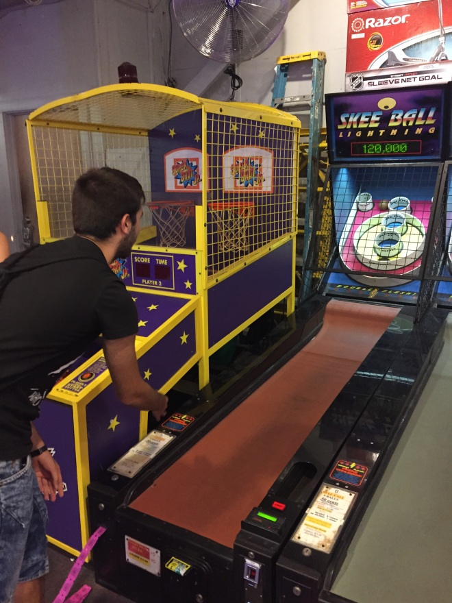Alberto playing skee ball for the first time - I know - it doesn't say skee ball, but it's a version of it
