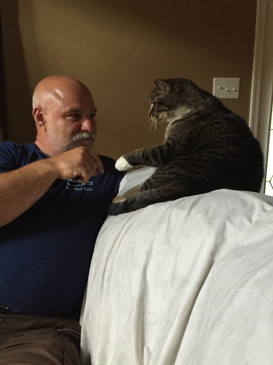 Bill playing with Shannon's cat, Harley