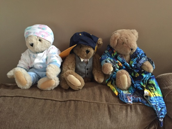 Andrew's bears - one is wearing the outfit he was brought home from the hospital in, one is wearing his fav cap, the other is wearing a shirt Bill and I brought him from Jamaica