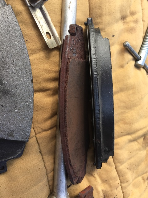 the worn out pad on the left, new one on the right