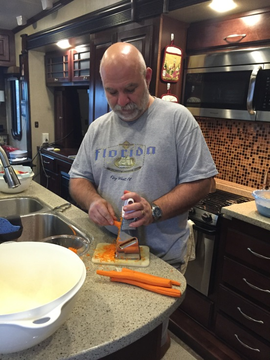 Bill starting the cake - yes, he grates his own carrots!