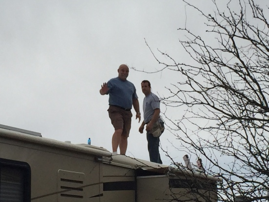 the men up on the roof