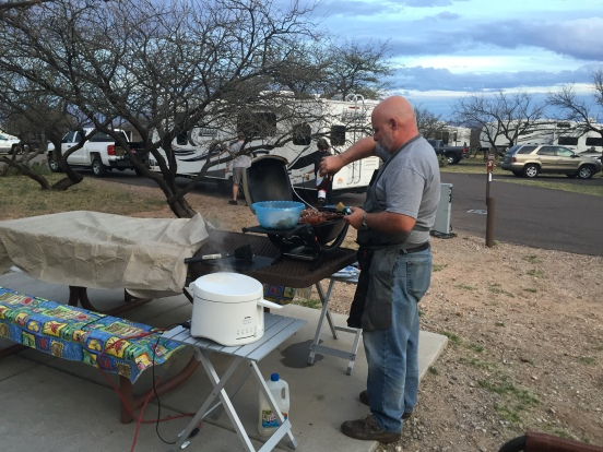 Bill - finishing the baby back ribs on the grill while frying the chicken wings at the same time - multi-talented man I have!