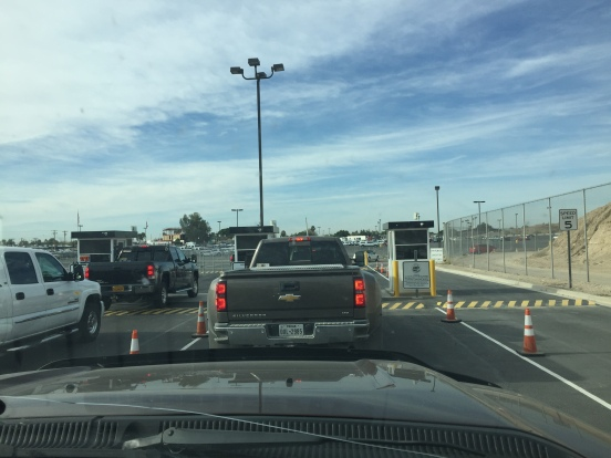 following Red through the gate into the parking lot on the USA side